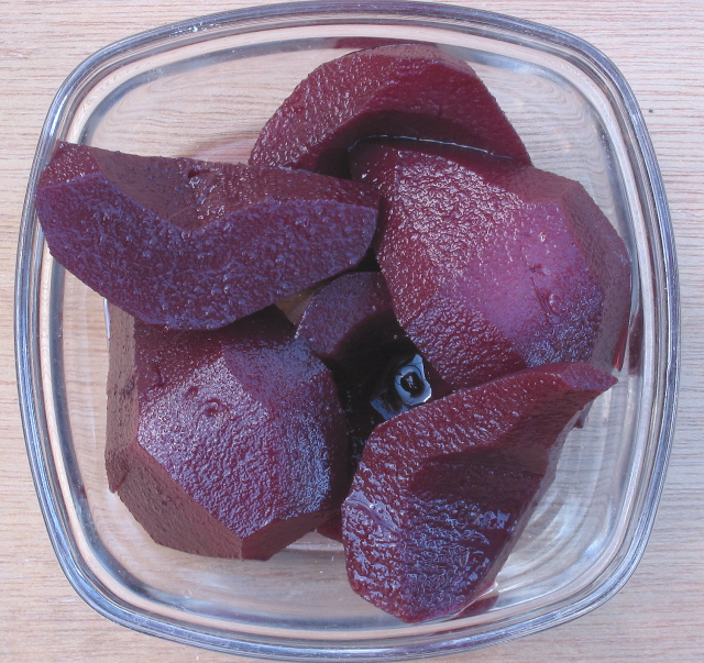 Pears cooked in red wine